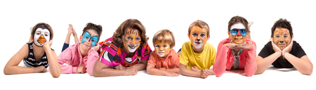 Photo pour Children's group and grandmother all with animal face-paint isolated in white - image libre de droit