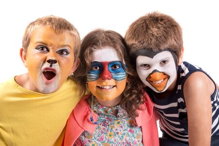 Photo pour Children's group with animal face-paint isolated in white - image libre de droit