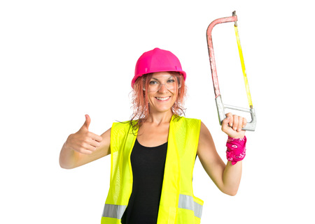 Worker woman with hacksaw doing good signal