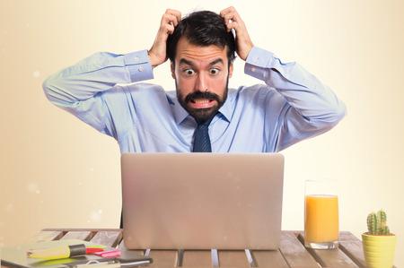 Foto de frustrated businessman over white background - Imagen libre de derechos