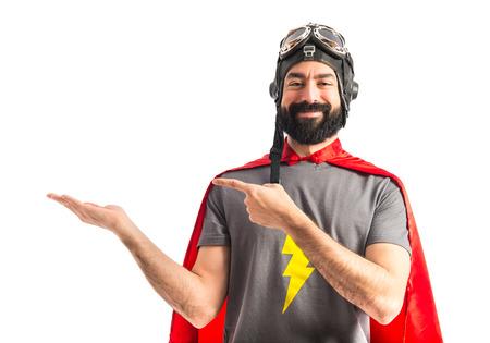 Photo pour Superhero holding something - image libre de droit