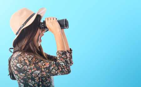 Surprised woman with binoculars