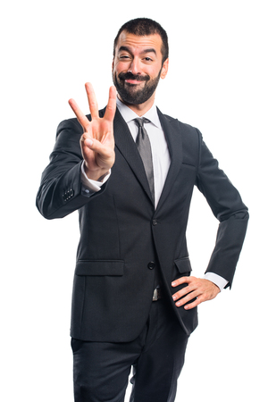 Photo pour Businessman counting three - image libre de droit