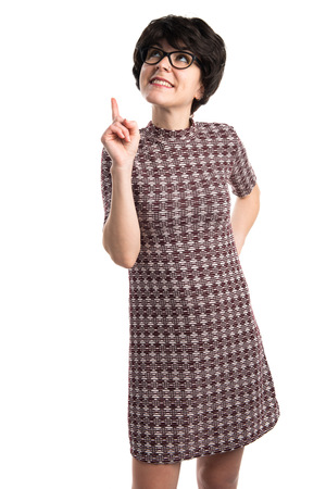 Girl with vintage look pointing up
