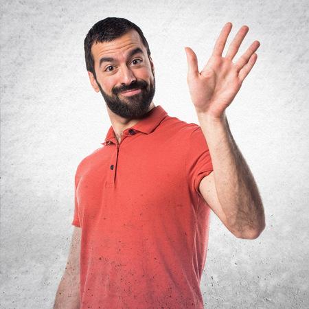 Photo pour Handsome man saluting - image libre de droit