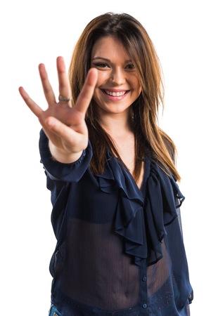 Photo pour Young girl counting four - image libre de droit