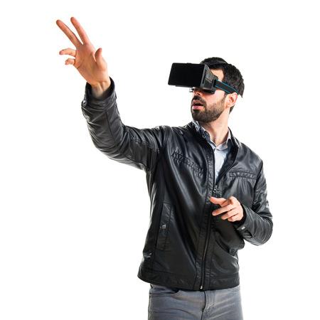 Photo pour Man using VR glasses - image libre de droit