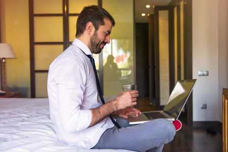 Young businessman worning in hotel