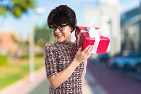Brunette girl holding a gift
