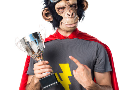 Superhero monkey man holding a trophy