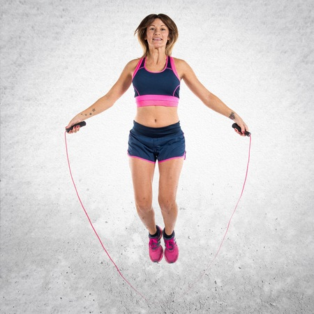 Sport woman jumping rope