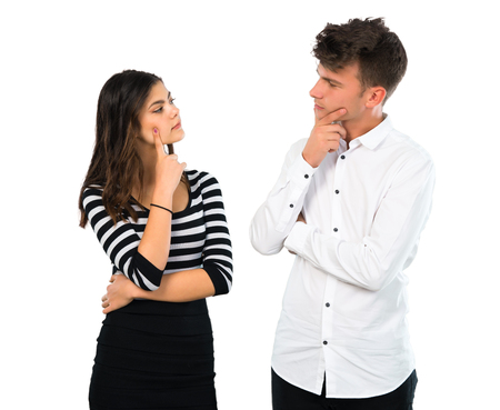 Photo pour Young couple  having doubts and with confuse face expression on isolated white background - image libre de droit