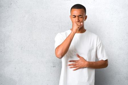 Foto de Young african american man is suffering with cough and feeling bad - Imagen libre de derechos