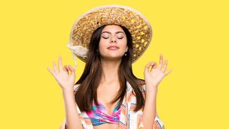 Photo pour Teenager girl on summer vacation in zen pose over isolated yellow background - image libre de droit