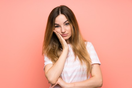 Photo pour Young woman over isolated pink wall unhappy and frustrated - image libre de droit