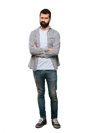 Photo pour Handsome man with beard feeling upset over isolated white background - image libre de droit
