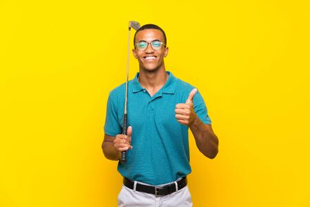 Photo pour African American golfer player man with thumbs up because something good has happened - image libre de droit