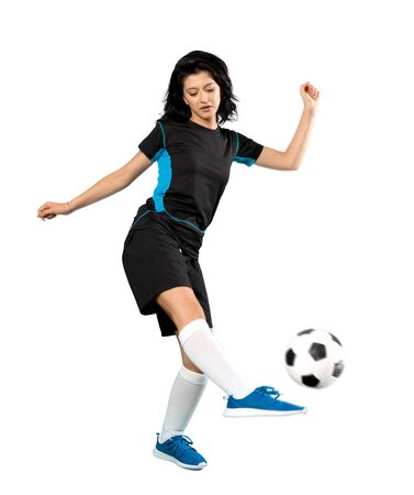 Photo pour A full-length shot of a Young football player woman over isolated white background - image libre de droit