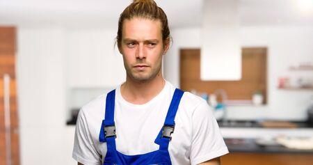 Photo pour Workman feeling upset in a house - image libre de droit