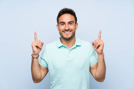 Photo for Handsome young man over isolated background pointing up a great idea - Royalty Free Image