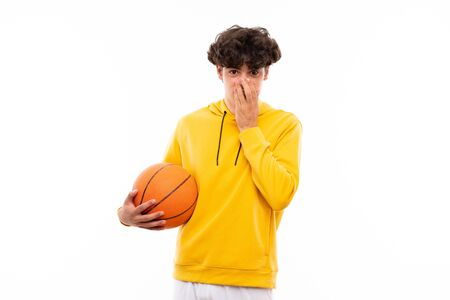 Photo pour Young basketball player man over isolated white wall with surprise facial expression - image libre de droit