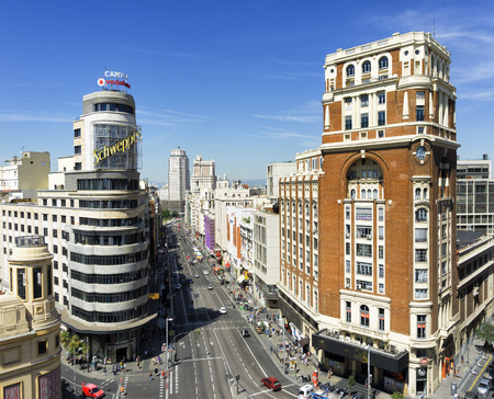 Citiscape Madrid, with the Gran Via street, the Capitol and the Palace of the Press Palace of the Press