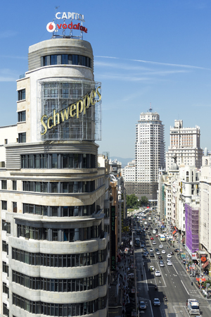 Madrid citiscape, with Capitol building besides the Gran Via street, in Spain