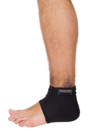 young male with ankle support to treat a sprain (isolated on white background)