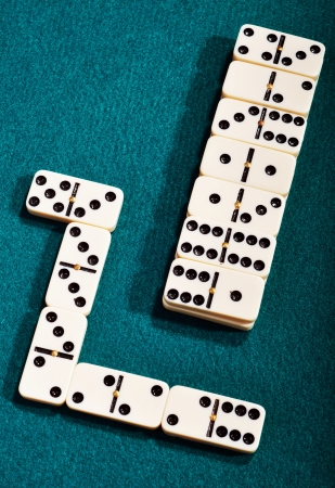 domino pieces on a green cloth background