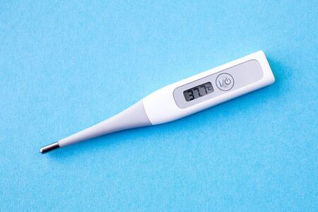 Photo for detail of digital thermometer with 37,7 ? C of fever, flu, covid19, virus, - Royalty Free Image
