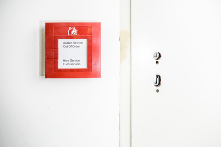 Fire detection button on wall