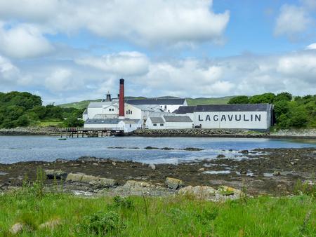 Islay, Scotland - Sseptember 11 2015: The sun shines on Lagavulin distillery warehouse