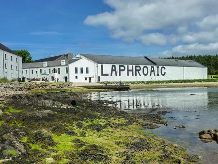 Islay, Scotland - Sseptember 11 2015: The sun shines on Laphroaig distillery warehouse