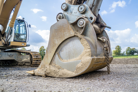 Photo for Excavator shovel resting on the ground - Royalty Free Image