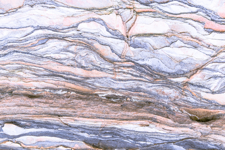 Foto per Rock layers - a colorful formations of rocks stacked over the hundreds of years. Interesting background with fascinating texture - Immagine Royalty Free