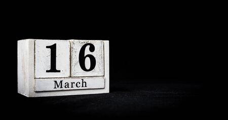 March 16th, Sixteenth of March, Day 16 of month March - white calendar blocks on black textured background with empty space for text