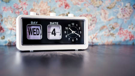 Photo for Wednesday 4th of the month - white vintage alarm clock with set date and time - Royalty Free Image