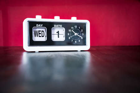 Photo for Wednesday 1st, First Wednesday of the month - white vintage alarm clock with set date and time - Royalty Free Image