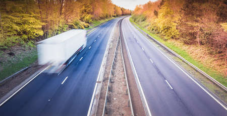 Photo for White truck on empty dual motorway in UK - drivers are key workers - Royalty Free Image