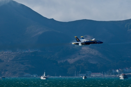 SAN FRANCISCO, CA - OCTOBER 7: US NAVY Demonstration Squadron Blue Angels, flying on Boeing F/A-18 Hornet showing precision of flying and the highest level of pilot skills during Fleet Week on October 7, 2012 in San Francisco, CA.