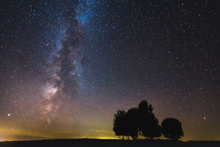 Photo for Landscape with Milky way galaxy glowing in the night sky - Royalty Free Image