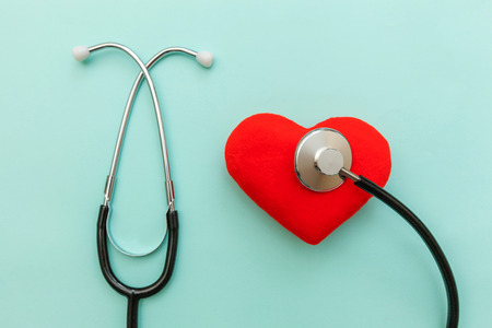 Photo pour Simply minimal design with medicine equipment stethoscope or phonendoscope and red heart isolated on trendy pastel blue background. Instrument device for doctor. Health care life insurance concept - image libre de droit