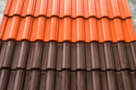 Photo for Samples of ceramic roofing tiles in a warehouse of a roofing materials store. Modern roof made of metal. cement sand tiles. - Royalty Free Image