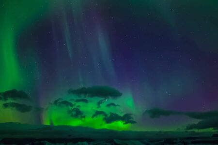 Photo pour Aurora borealis in the night northern sky. Ionization of air particles in the upper atmosphere. - image libre de droit