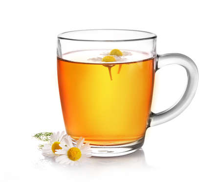 Photo pour Chamomile herbal tea in glass cup with flower buds isolated on white background. - image libre de droit