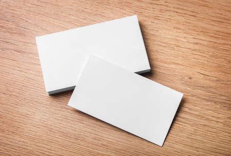 Foto de Blank business cards on wooden background. Top view. - Imagen libre de derechos