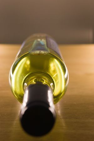 Unopened wine bottle on a wooden table