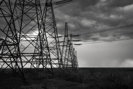 Photo for high-voltage  power lines at storm clouds. electricity distribution station. high voltage electric transmission tower. - Royalty Free Image