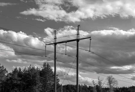 Photo for high-voltage power lines at clouds in the forest. electricity distribution station. high voltage electric transmission tower. - Royalty Free Image