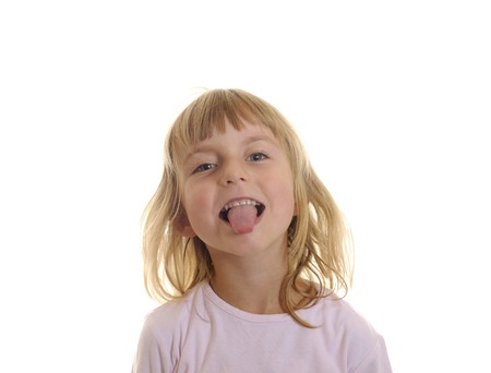 little girl puts out her tongue